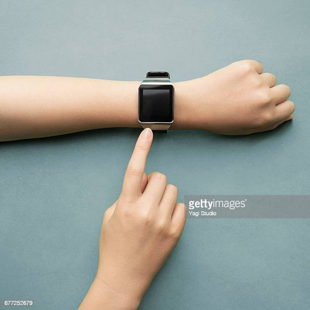 woman using a smart watch. - smart watch stock pictures, royalty-free photos & images
