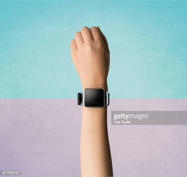 woman using a smart watch. - wearable computer stock pictures, royalty-free photos & images