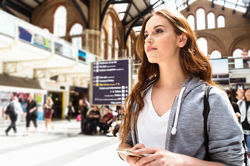 woman using a smartphone on liverpool street - gettyimageskorea