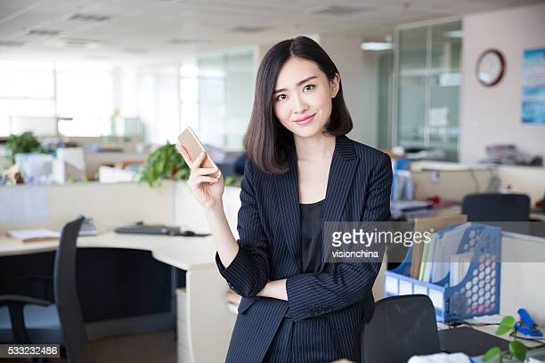 woman using a smartphone - beautiful asian girls stock photos and pictures