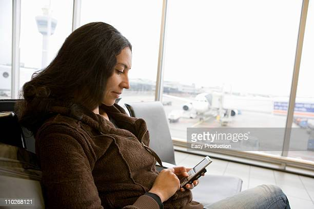 Woman using a smartphone waiting