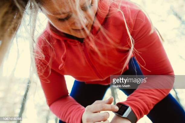 Woman using a smartwatch after jogging.