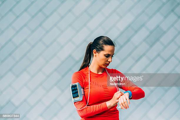 Woman Using A Sport Watch