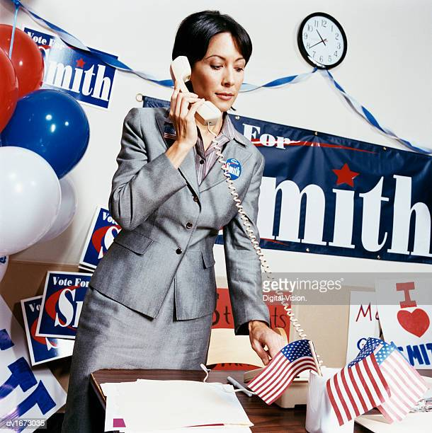 Woman Using a Telephone in an Election Campaign Office
