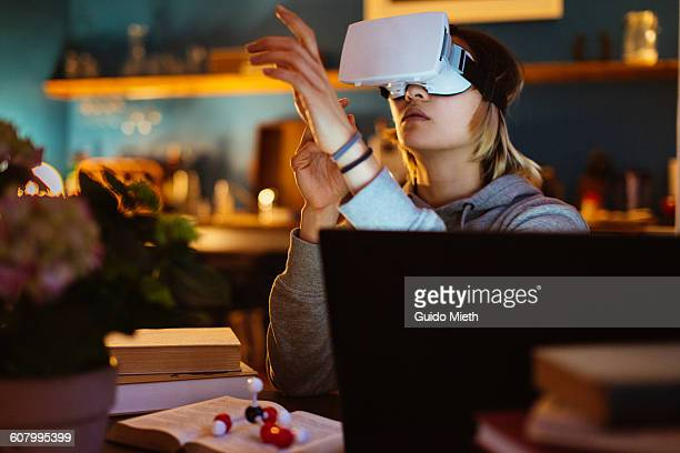 woman using a virtual reality headset. - cyberspace stock pictures, royalty-free photos & images