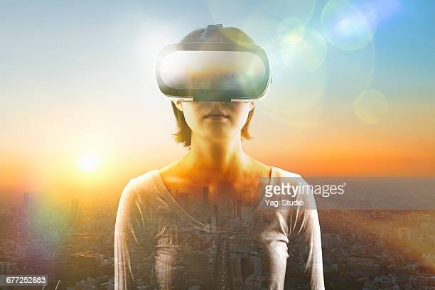woman using a virtual reality headset. - vr ストックフォトと画像