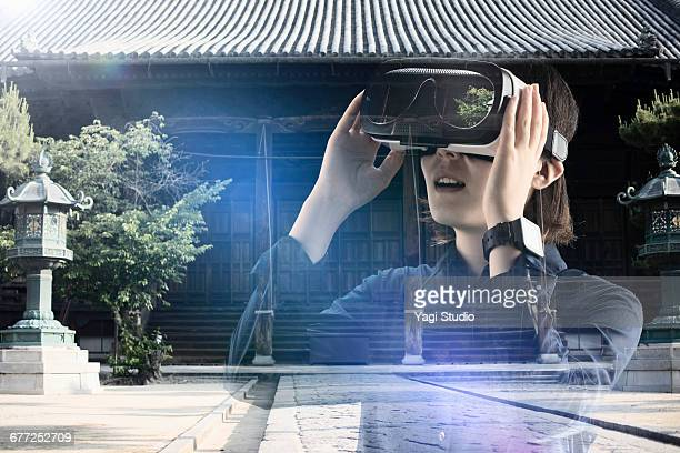 Woman using a virtual reality headset.
