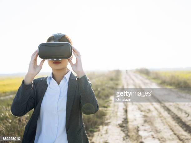 woman using a Virtual reality simulator at countryside