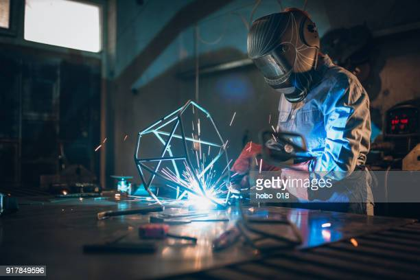 woman using a welding machine - artistic product stock pictures, royalty-free photos & images