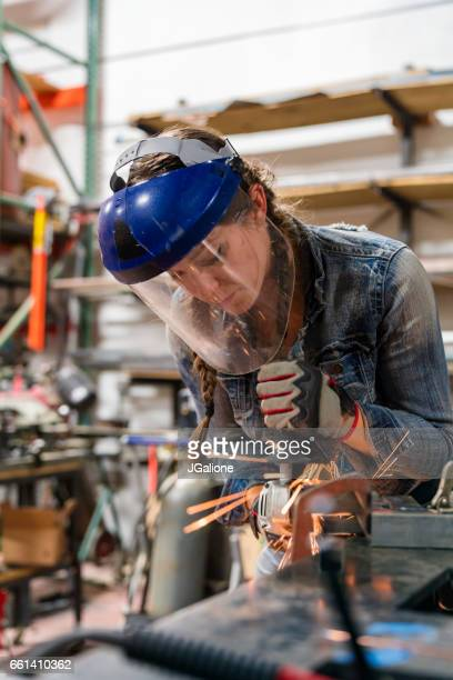 Woman using an angle grinder
