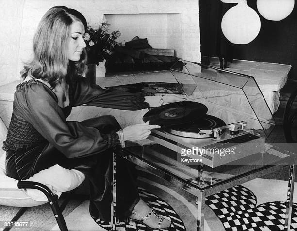 A woman using an automatic record player made by Philips at the International Radio Show in Berlin circa 1974 The turntable automatically places the...