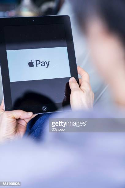 A woman using an iPad as she uses Apple Pay on November 27 2017 in Hong Kong Hong Kong