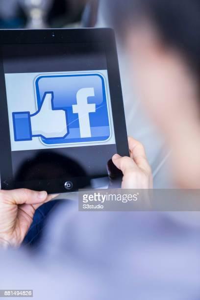 A woman using an iPad as she uses Facebook on November 27 2017 in Hong Kong Hong Kong