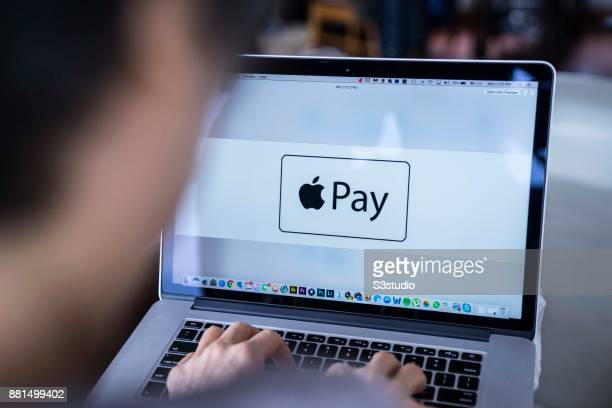 A woman using an Macbook Pro as she uses Apple Pay on November 27 2017 in Hong Kong Hong Kong
