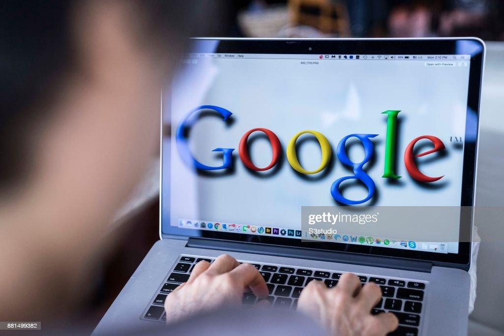 A woman using an Macbook Pro as she uses Google on November 27, 2017 in Hong Kong, Hong Kong.