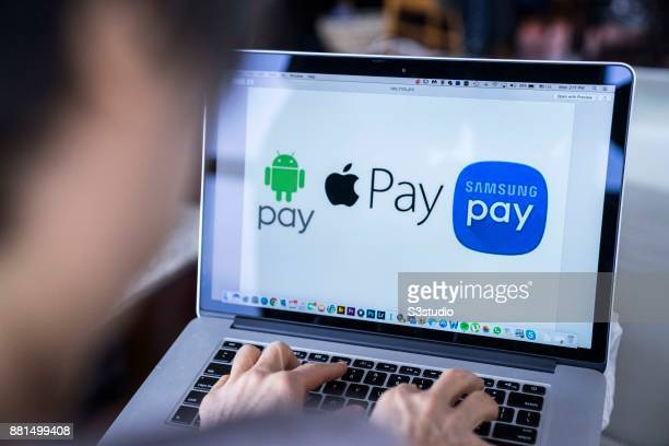 A woman using an Macbook Pro as she uses Google Pay Apple Pay Samsung Pay on November 27 2017 in Hong Kong Hong Kong