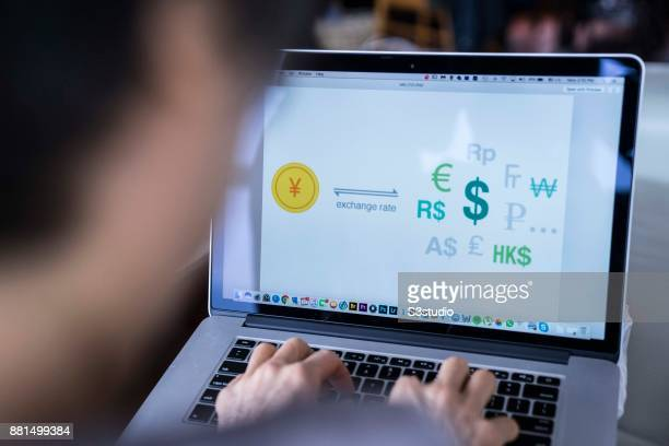 A woman using an Macbook Pro as she uses online for money exchanges on November 27 2017 in Hong Kong Hong Kong