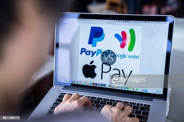 A woman using an Macbook Pro as she uses PayPal Google Wallet Apple Pay on November 27 2017 in Hong Kong Hong Kong