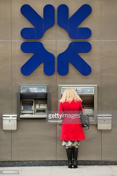 A woman using an RBS cashpoint