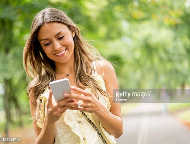 Woman using app on her mobile phone outdoors