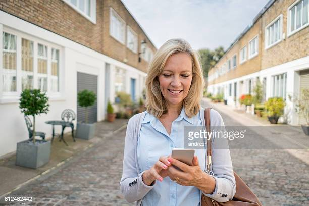 Woman using app on her mobile phone