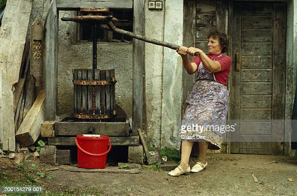 Woman using apple press