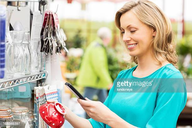 Woman Using Barcode Reader Through Cell Phone