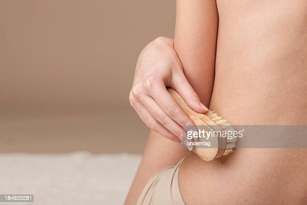 woman using bath brush