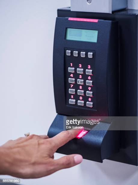 Woman using biometric fingerprint scanner