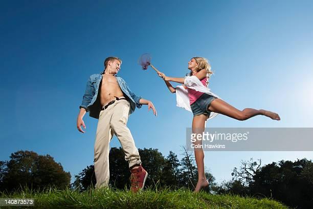 woman using butterfly net on boyfriend - homem pegando mulher imagens e fotografias de stock