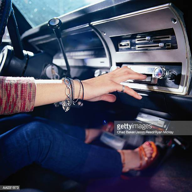 Woman Using Car Stereo