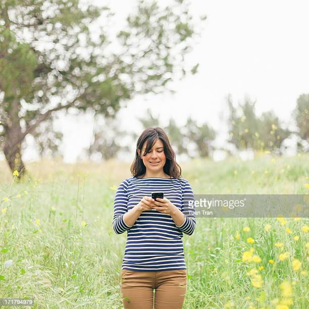 woman using cell phone outdoor