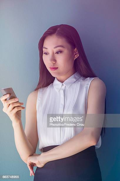 Woman using cell phone to text message