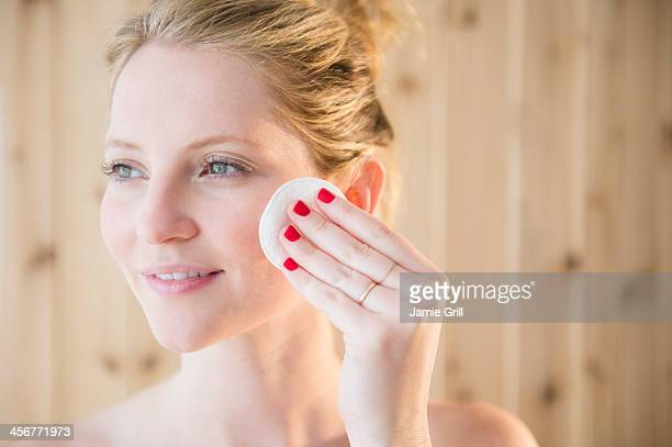 Woman using cleansing pad