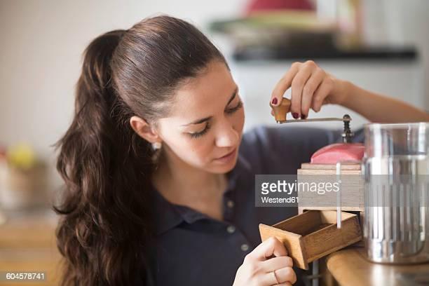 Woman using coffee mill