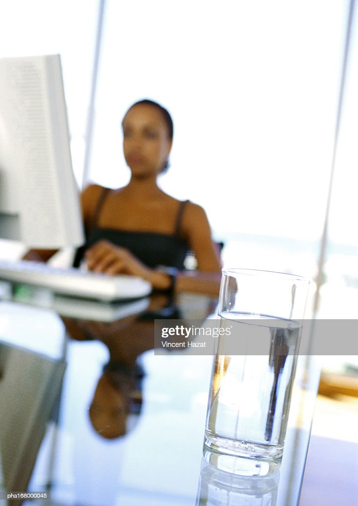Woman using computer, blurred : Stockfoto