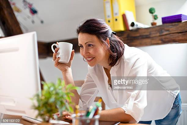 Woman Using computer In Her Office