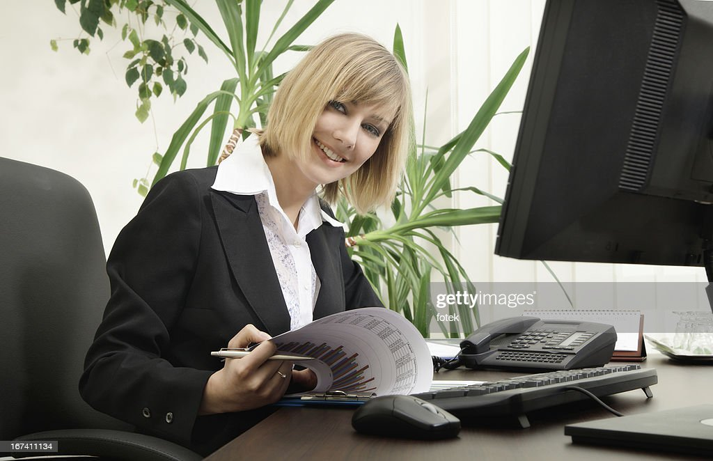 Woman using computer : Bildbanksbilder