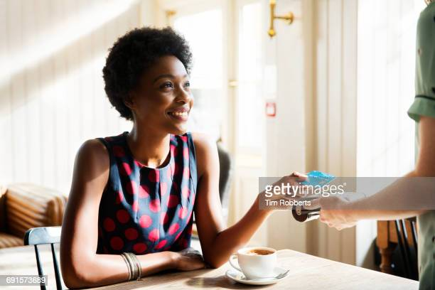 woman using contactless payment - giving stock pictures, royalty-free photos & images