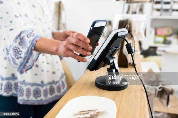 Woman using contactless payment