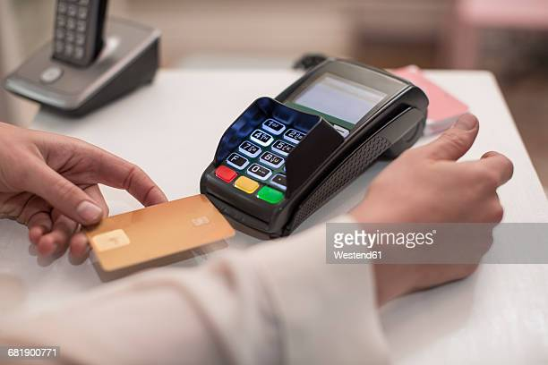 woman using credit card reader - credit card reader stock pictures, royalty-free photos & images