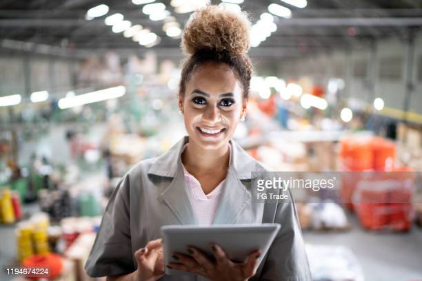 woman using digital tablet and working in the industry - pardo brazilian stock pictures, royalty-free photos & images