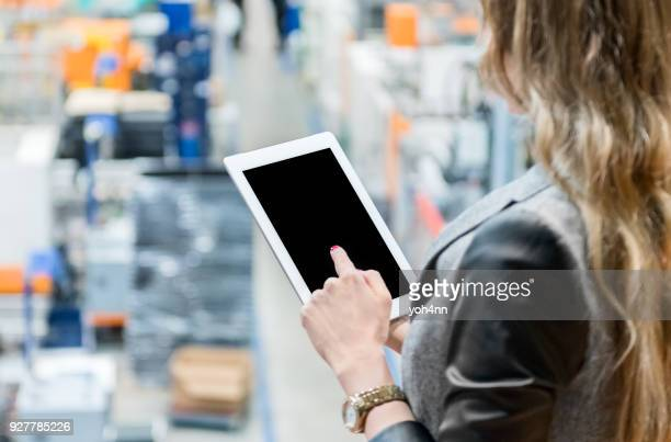 Woman using digital tablet & business strategy