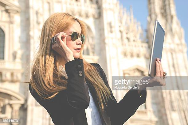 Woman Using Digital Tablet - Duomo, Milan, Italy
