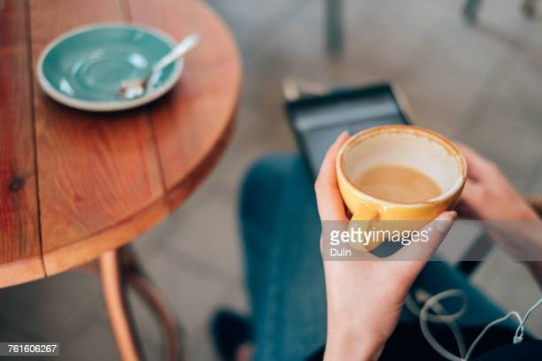 Woman using digital tablet in a cafe