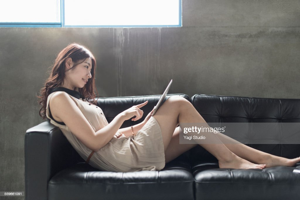 Woman using  digital tablet in casual office : ストックフォト