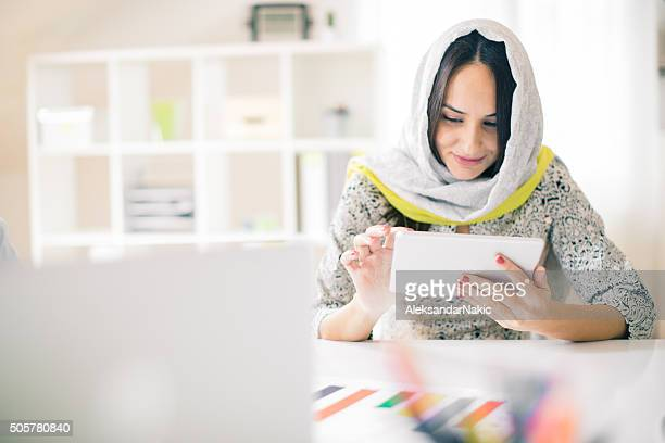 Woman using digital tablet in the office
