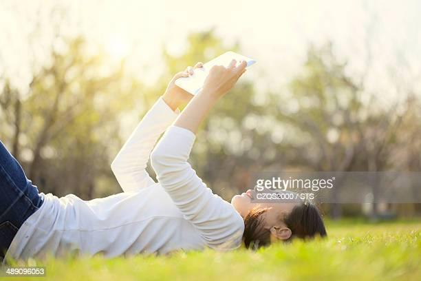 woman using digital tablet outdoor