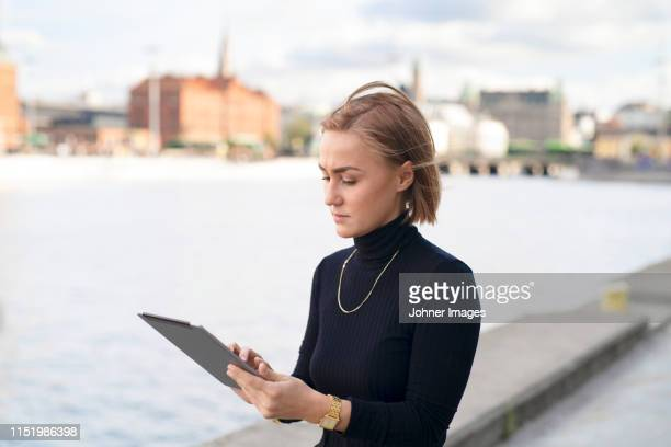 woman using digital tablet - malmo stock pictures, royalty-free photos & images