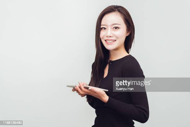 woman using digital tablet - straight hair stock pictures, royalty-free photos & images
